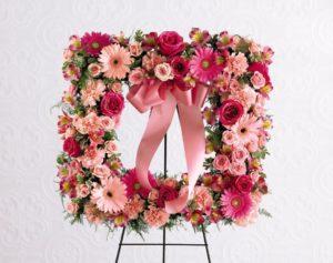 hermosa corona rectangular de rosas y gerberas  disponible para hombre  1300 pesos