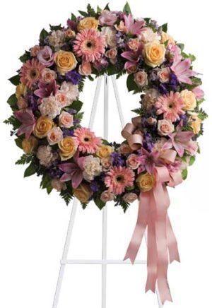 elegante corona de rosas gerberas lilis 1500 pesos